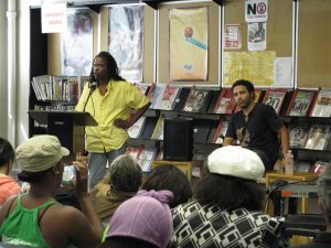 Panelists Speak with Students in Library