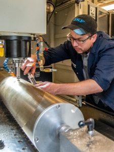 Adam Balogh Measuring PArt in CNC Machine.